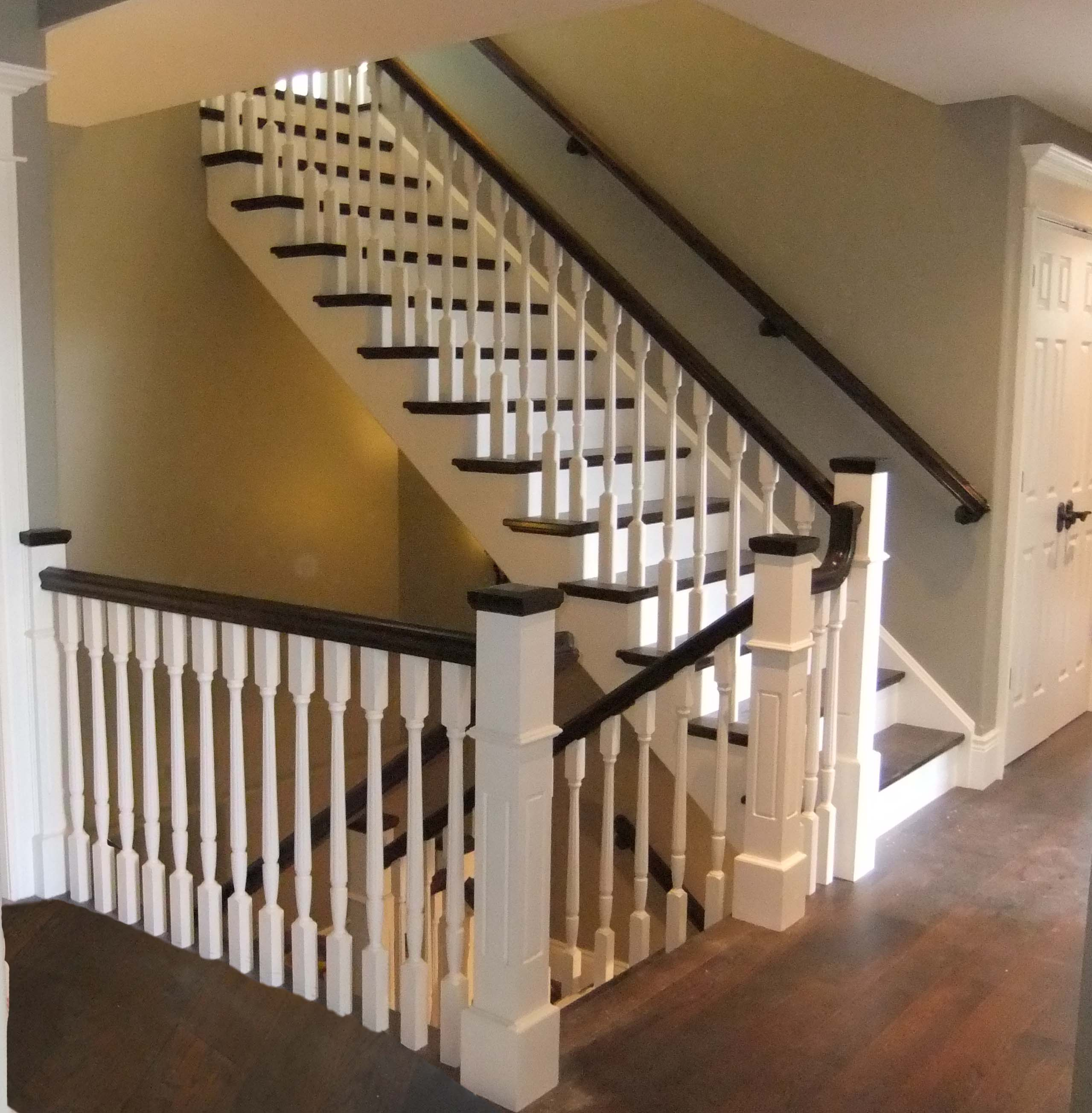 Straight paint grade custom wood stairs with hardwood tread