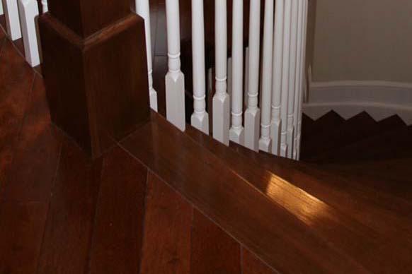 Nosing at head of stairs abutting hardwood flooring